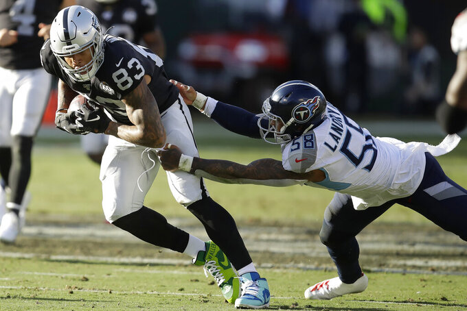 Oakland Raiders tight end Darren Waller (83) runs past Tennessee Titans linebacker Harold Landry (58) during the first half of an NFL football game in Oakland, Calif., Sunday, Dec. 8, 2019. (AP Photo/Ben Margot)