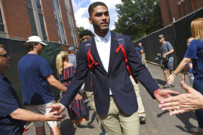 Mississippi quarterback Jordan Ta'amu greets fans during the Walk of Champions before an NCAA college football game between Louisiana Monroe and Mississippi in Oxford, Miss., Saturday, Oct. 6, 2018. (AP Photo/Thomas Graning)