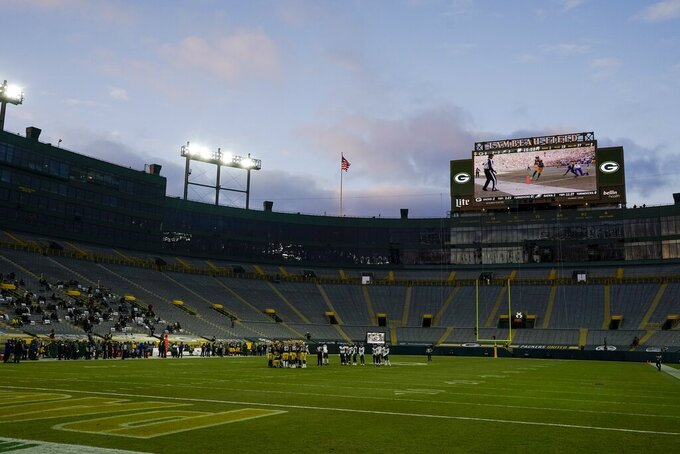 The seats are nearly empty at Lambeau Field during the second half of an NFL football game between the Green Bay Packers and the Philadelphia Eagles Sunday, Dec. 6, 2020, in Green Bay, Wis. (AP Photo/Morry Gash)