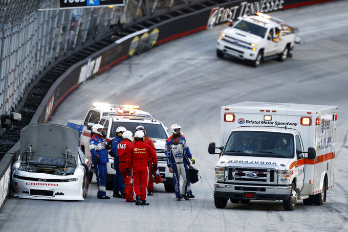 Mason Diaz makes his way to the ambulance after a crash during the NASCAR Xfinity Series auto race Friday, Aug. 16, 2019, in Bristol, Tenn. (AP Photo/Wade Payne)