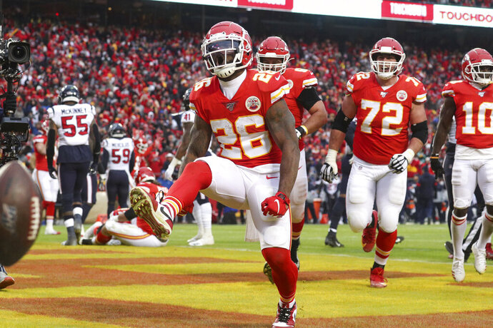 Kansas City Chiefs running back Damien Williams (26) celebrates a touchdown in an NFL divisional playoff game against the Houston Texans, Sunday, Jan. 12, 2020 in Kansas City. The Chiefs defeated the Texans 51-31 (Margaret Bowles via AP)