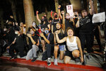 Protesters rally Monday, June 1, 2020, in Las Vegas, over the death of George Floyd, a black man who was in police custody in Minneapolis. (AP Photo/John Locher)