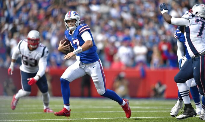 Buffalo Bills quarterback Josh Allen scrambles against the New England Patriots in the second half of an NFL football game, Sunday, Sept. 29, 2019, in Orchard Park, N.Y. (AP Photo/Adrian Kraus)