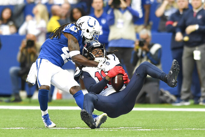 Houston Texans wide receiver DeAndre Hopkins (10) is tackled by dIndianapolis Colts cornerback Shakial Taylor (47) during the first half of an NFL football game, Sunday, Oct. 20, 2019, in Indianapolis. (AP Photo/Doug McSchooler)