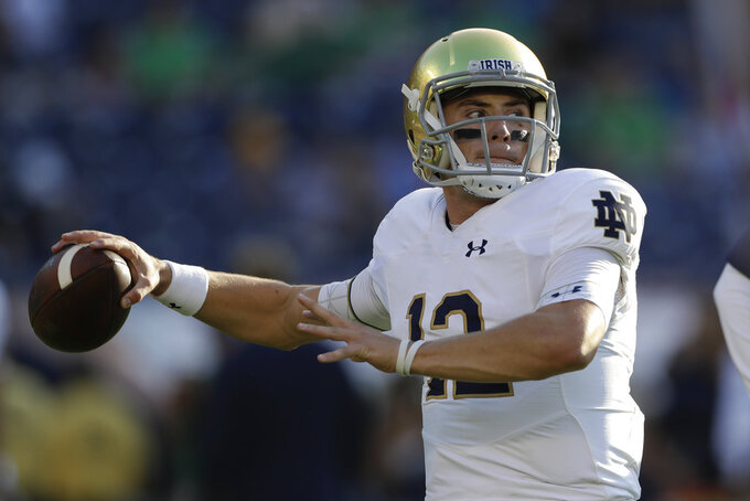 Notre Dame quarterback Ian Book warms up before facing Navy in an NCAA college football game Saturday, Oct. 27, 2018, in San Diego. (AP Photo/Gregory Bull)