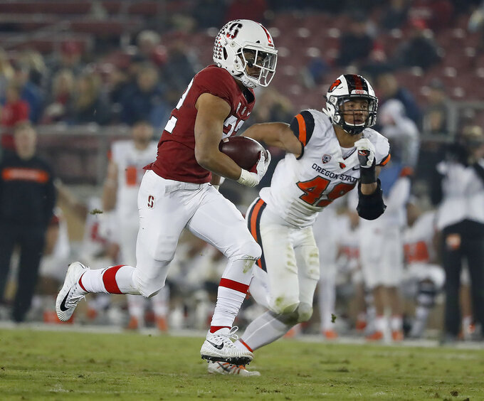 FILE - In this  Saturday, Nov. 10, 2018 file photo, Stanford running back Cameron Scarlett (22) rushes for a touchdown against Oregon State during an NCAA college football game in Stanford, Calif. Pittsburgh plays Stanford in the Sun Bowl Monday, Dec. 31, 2018. (AP Photo/Tony Avelar)