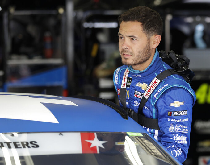 Kyle Larson climbs into his car before practice for Sunday's NASCAR Coca-Cola 600 Cup series auto race at Charlotte Motor Speedway in Concord, N.C., Thursday, May 23, 2019. (AP Photo/Chuck Burton)