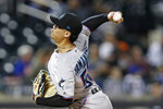 Miami Marlins starting pitcher Jordan Yamamoto winds up during the third inning of a baseball game against the New York Mets, Thursday, Sept. 26, 2019, in New York. (AP Photo/Kathy Willens)