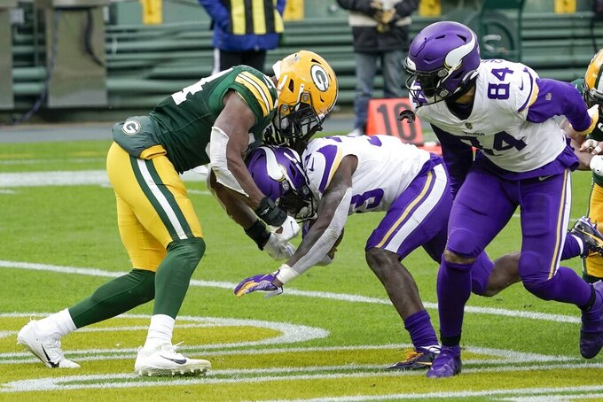 Minnesota Vikings' Dalvin Cook runs for a touchdown during the first half of an NFL football game against the Green Bay Packers Sunday, Nov. 1, 2020, in Green Bay, Wis. (AP Photo/Morry Gash)