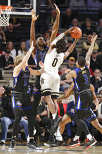 Vanderbilt guard Saben Lee (0) drives against Tulsa defenders Lawson Korita (5), Emmanuel Ugboh (12) and Elijah Joiner (3) during the second half of an NCAA college basketball game Saturday, Nov. 30, 2019, in Nashville, Tenn. (AP Photo/Mark Humphrey)