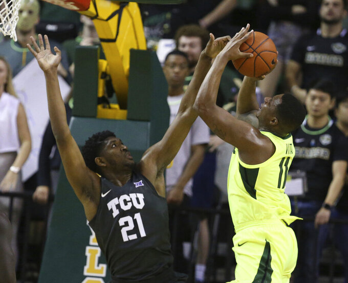 Baylor guard Mark Vital, right, attempts to shoot over TCU center Kevin Samuel, left, in the first half of an NCAA college basketball game, Saturday, Feb. 2, 2019, in Waco, Texas. (Rod Aydelotte/Waco Tribune Herald, via AP)