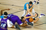 Utah Jazz's Georges Niang (31) grabs a loose ball in front of Memphis Grizzlies' Grayson Allen (3) and De'Anthony Melton (0) during the second half of an NBA basketball game Wednesday, Aug. 5, 2020, in Lake Buena Vista, Fla. (Kevin C. Cox/Pool Photo via AP)