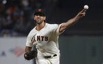 San Francisco Giants pitcher Madison Bumgarner throws to a Philadelphia Phillies batter during the fifth inning of a baseball game in San Francisco, Thursday, Aug. 8, 2019. (AP Photo/Jeff Chiu)