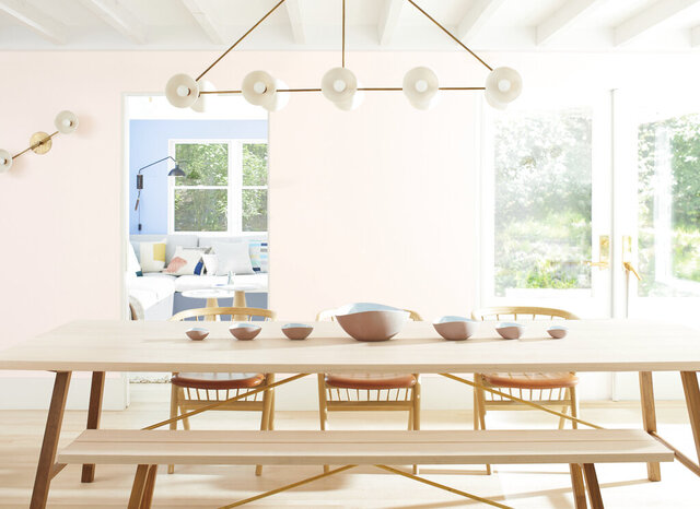 This photo provided by Benjamin Moore shows a room with Benjamin Moor'es 2020 Color of the Year called First Light, a dreamy, soft shade of pink. Director of Color Marketing & Development Andrea Magno says that while the color was already part of the 3500-hue library,