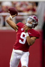 Alabama quarterback Bryce Young (9) throws long against Mercer during the first half of an NCAA college football game, Saturday, Sept. 11, 2021, in Tuscaloosa, Ala. (AP Photo/Vasha Hunt)