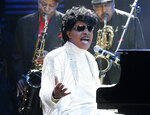 "FILE - In this May 30, 2009 file photo, Little Richard performs at The Domino Effect, a tribute concert to New Orleans rock and roll musician Fats Domino, at the New Orleans Arena in New Orleans. ESPN is changing their ""Monday Night Football"" theme song. The season will feature a new version of Little Richard's hit ""Rip It Up,"" featuring new instrumentals and backup vocals from the Virginia-based band Butcher Brown. Hank Williams Jr. had sung the theme song for years in a version of his hit ""All My Rowdy Friends Are Coming Over Tonight."" (AP Photo/Patrick Semansky, File)"