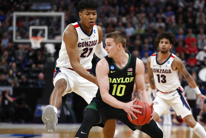 Baylor guard Makai Mason (10) looks to pass against Gonzaga forward Rui Hachimura (21) during the first half of a second-round game in the NCAA men's college basketball tournament Saturday, March 23, 2019, in Salt Lake City. (AP Photo/Jeff Swinger)