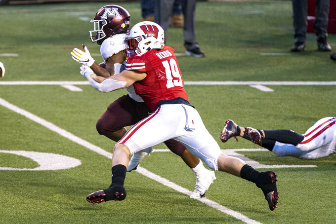 FILE - In this Dec. 19, 2020, file photo, Wisconsin linebacker Nick Herbig (19) tackles Minnesota running back Mohamed Ibrahim (24) during the first half of an NCAA college football game in Madison, Wis. Wisconsin faces Penn State on Saturday as they open their college football season. (AP Photo/Andy Manis, File)