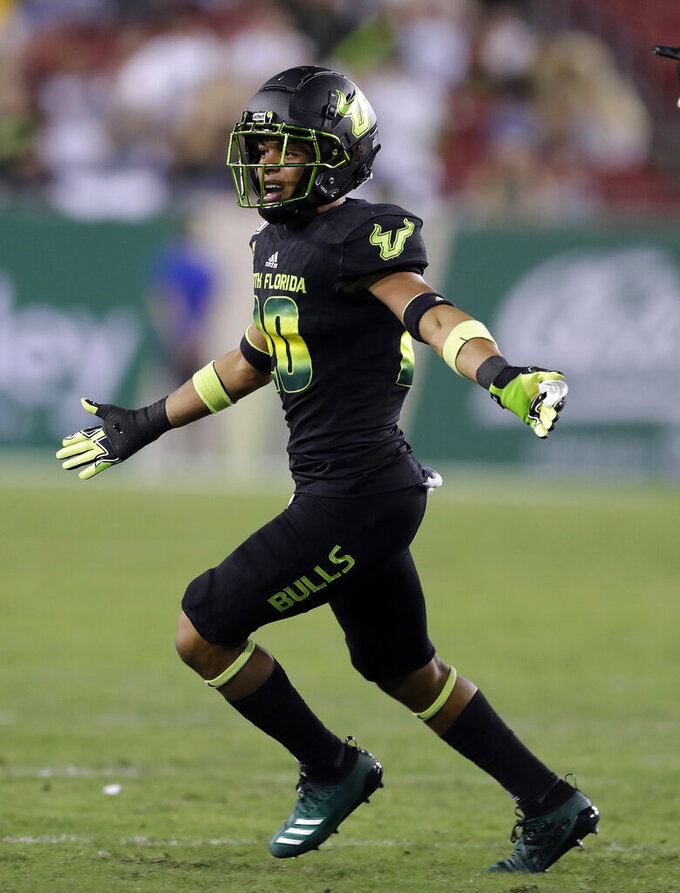 South Florida defensive back Bentlee Sanders celebrates after intercepting a pass by Temple quarterback Anthony Russo during the second half of an NCAA college football game Thursday, Nov. 7, 2019, in Tampa, Fla. (AP Photo/Chris O'Meara)