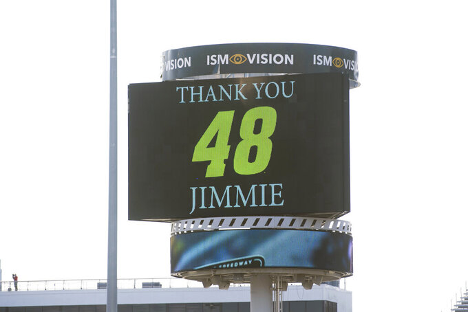 The jumbo screen in the infield pays tribute to Jimmie Johnson during a NASCAR Cup Series auto race at the Martinsville Speedway in Martinsville, Va., Sunday, Nov.1, 2020. (AP Photo/Lee Luther Jr.)