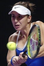 Belinda Bencic of Switzerland hits a return shot against Elina Svitolina of Ukraine during the WTA Finals Tennis Tournament at the Shenzhen Bay Sports Center in Shenzhen, China's Guangdong province, Saturday, Nov. 2, 2019. (AP Photo/Andy Wong)