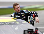 William Byron climbs out of his car after his qualifying run for the Daytona 500 auto race at Daytona International Speedway, Sunday, Feb. 10, 2019, in Daytona Beach, Fla. (AP Photo/John Raoux)