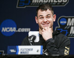 Wofford's Fletcher Magee answers questions during a news conference at the NCAA men's college basketball tournament in Jacksonville, Fla., Friday, March 22, 2019. Wofford faces Kentucky in the second round on Saturday.  (AP Photo/Stephen B. Morton)