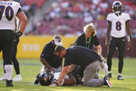 Baltimore Ravens running back J.K. Dobbins (27) lays on the ground after suffering an injuring during the first half of a preseason NFL football game against the Washington Football Team, Saturday, Aug. 28, 2021, in Landover, Md. (AP Photo/Carolyn Kaster)