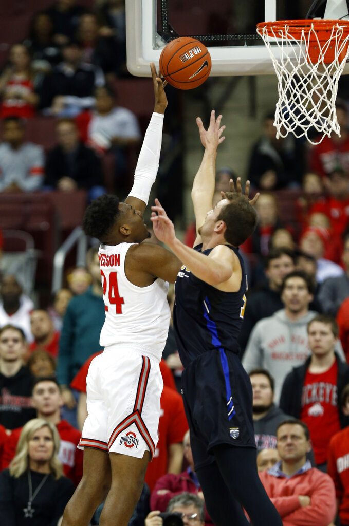 Ohio State forward Andre Wesson, left, goes up for a shot against Purdue Fort Wayne forward Matt Holba during the first half of an NCAA college basketball game in Columbus, Ohio, Friday, Nov. 22, 2019. (AP Photo/Paul Vernon)