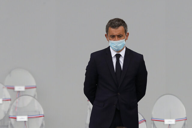 France's Interior Minister Gerald Darmanin attends the Bastille Day military parade, Tuesday, July 14, 2020 in Paris. France are honoring nurses, ambulance drivers, supermarket cashiers and others on its biggest national holiday Tuesday. Bastille Day's usual grandiose military parade in Paris is being redesigned this year to celebrate heroes of the coronavirus pandemic. (AP Photo/Christophe Ena, Pool)