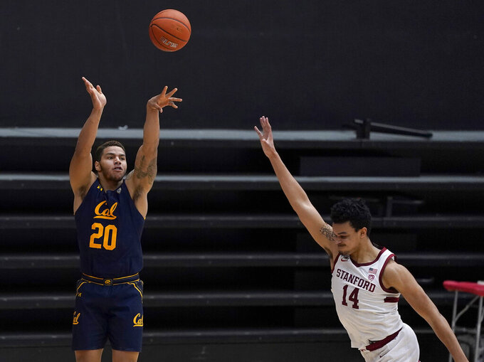 California guard Matt Bradley (20) shoots against Stanford forward Spencer Jones (14) during the first half of an NCAA college basketball game in Stanford, Calif., Sunday, Feb. 7, 2021. (AP Photo/Tony Avelar)