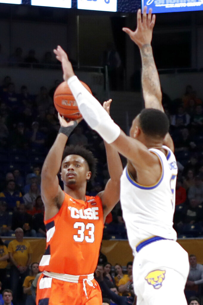 Syracuse's Elijah Hughes (33) shoots as Pittsburgh's Au'Diese Toney (5) defends during the first half of an NCAA college basketball game, Wednesday, Feb. 26, 2020, in Pittsburgh. Syracuse won 72-49. (AP Photo/Keith Srakocic)