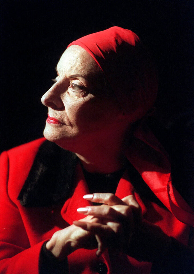 FILE - In this Jan. 27, 1998, file photo, Alicia Alonso, founder of the Ballet Nacional de Cuba, listens during an interview in New York. Cuba's national ballet has reported that Alonso has died on Oct. 17, 2019. (AP Photo/Bebeto Matthews, File)