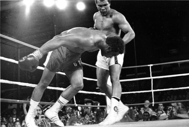 FILE - In this Oct. 30, 1974, file photo, challenger Muhammad Ali, top, watches as defending world champion George Foreman goes down to the canvas in the eighth round of their WBA/WBC championship match in Kinshasa, Zaire. The 1996 film
