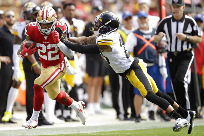 San Francisco 49ers running back Matt Breida (22) is pushed out of bounds by Pittsburgh Steelers cornerback Joe Haden during the first half of an NFL football game in Santa Clara, Calif., Sunday, Sept. 22, 2019. (AP Photo/Ben Margot)