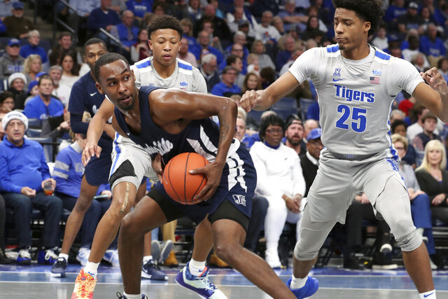 Memphis guard Jayden Hardaway (25) defends Jackson State guard Tristan Jarrett (4) in the first half of an NCAA college basketball game Saturday, Dec. 21, 2019, in Memphis, Tenn. (AP Photo/Karen Pulfer Focht)