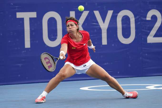 Carla Suárez Navarro, of Spain, plays Karolina Pliskova, of the Czech Republic, during the second round of the tennis competition at the 2020 Summer Olympics, Monday, July 26, 2021, in Tokyo, Japan. (AP Photo/Seth Wenig)