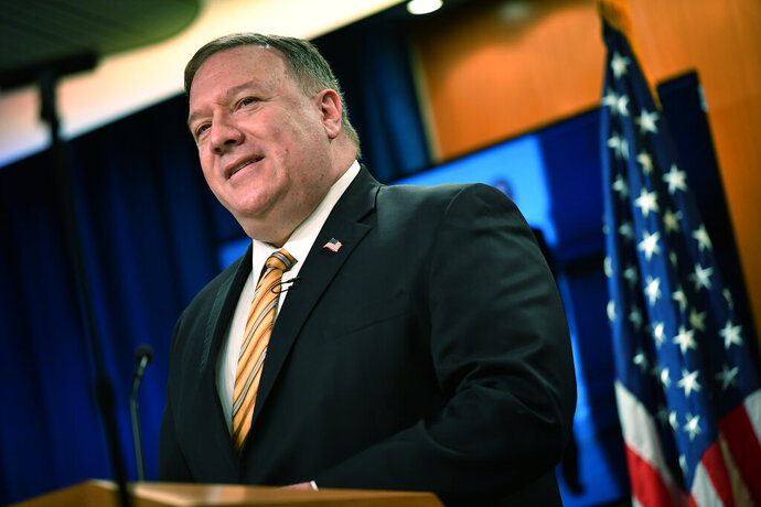FILE - In this Wednesday, June 24, 2020 file photo, US Secretary of State Mike Pompeo speaks during a news conference at the State Department in Washington. On Tuesday, June 30, 2020, Pompeo and Iran's Foreign Minister Mohammed Javad Zarif are scheduled to address a U.N. Security Council meeting on implementation of the 2015 Iran nuclear deal that the Trump administration pulled out of as tensions between the two countries escalate. Tuesday's long-scheduled council meeting comes a day after Iran issued an arrest warrant for President Donald Trump and dozens of others for alleged involvement in the killing of an Iranian general. A key issue at Tuesday's meeting is expected to be U.S. opposition to the lifting of a U.N. arms embargo on Iran in October. (Mandel Ngan/Pool via AP, File)