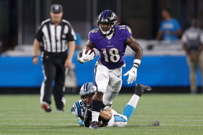 Baltimore Ravens running back Nate McCrary is is tackled by the Carolina Panthers during the first half of a preseason NFL football game Saturday, Aug. 21, 2021, in Charlotte, N.C. (AP Photo/Nell Redmond)