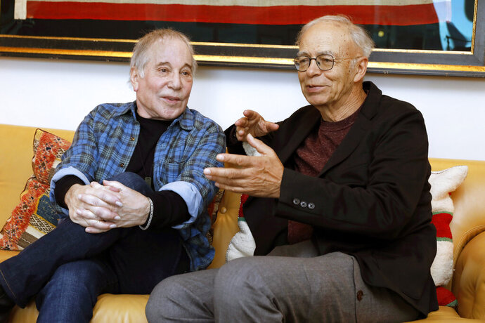 "This Nov. 8, 2019 photo shows singer-songwriter, Paul Simon, left, and author-philosopher Peter Singer during an interview in New York to promote the new edition of Singer's book ""The Life You Can Save."