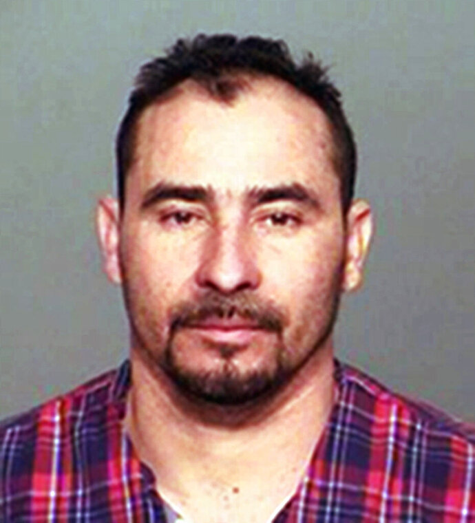 FILE - This file photo provided by the Indiana State Police shows Manuel Orrego-Savala, of Guatemala. Orrego-Savala, living illegally in the U.S., was convicted of drunk driving in a crash that killed Indianapolis Colts linebacker Edwin Jackson and his Uber driver has been sentenced to 42 months in federal prison for illegally re-entering the U.S. after having been deported. U.S. Attorney Josh Minkler announced 38-year-old Manuel Orrego-Zavala was sentenced after pleading guilty to the federal charge. Orrego-Zavala was sentenced last September to the maximum 16 years for the February 2018 crash that killed Jackson and Jeffrey Monroe. (Indiana State Police via AP, File)