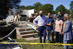 """FILE - President Joe Biden tours a neighborhood impacted by Hurricane Ida, Tuesday, Sept. 7, 2021, in Manville, N.J. Rep. Bonnie Watson Coleman, D-N.J., looks on at right. Not even a month after Ida's torrential leftovers dumped nearly a foot of rain in a few hours in places, turning roads into waterways and leaving 30 people dead, New Jersey's top environmental regulator said this week the state's floodplain property buyback program """"definitely needs expansion."""" (AP Photo/Evan Vucci, File)"""