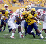 West Virginia defensive lineman Dante Stills (55) moves to tackle N.C. State running back Zonovan Knight (24) during the first half of an NCAA college football game against N.C. State on Saturday, Sept. 14, 2019, in Morgantown, W. Va. (Stephanie Panny/Times-West Virginian via AP)