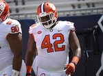 FILE - In this Sept. 22, 2018, file photo, Clemson defensive lineman Christian Wilkins (42) warms up before the first half of an NCAA college football game against Georgia Tech, in Atlanta. Wilkins has 6½ tackles for loss, including two sacks, and eight quarterback pressures on the season for the second-ranked Tigers' stingy defense. (AP Photo/Jon BarashNY151)