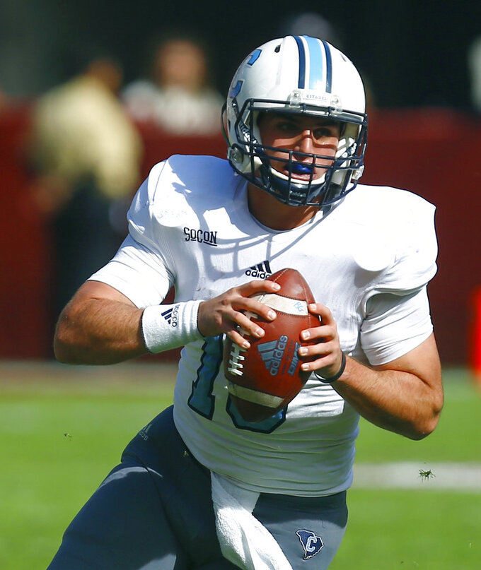 Citadel running back Brandon Rainey (16) scrambles for yardage during the first half of an NCAA college football game against Alabama, Saturday, Nov. 17, 2018, in Tuscaloosa, Ala. (AP Photo/Butch Dill)