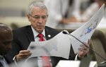 FILE - In this Sept. 12, 2019, file photo, Rep. John Szoka, R-Fayetteville, looks over a redistricting map during a committee meeting at the Legislative Office Building in Raleigh, N.C. Republican wins in state legislatures in 2010 put them in a commanding position to draw legislative and congressional maps the following year that essentially cemented their political power for a decade. (Robert Willett/The News & Observer via AP, File)