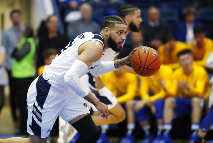 Nevada forward Cody Martin picks up a loose ball during the second half of the team's NCAA college basketball game against Air Force on Tuesday, March 5, 2019, at Air Force Academy, Colo. Nevada won 90-79. (AP Photo/David Zalubowski)