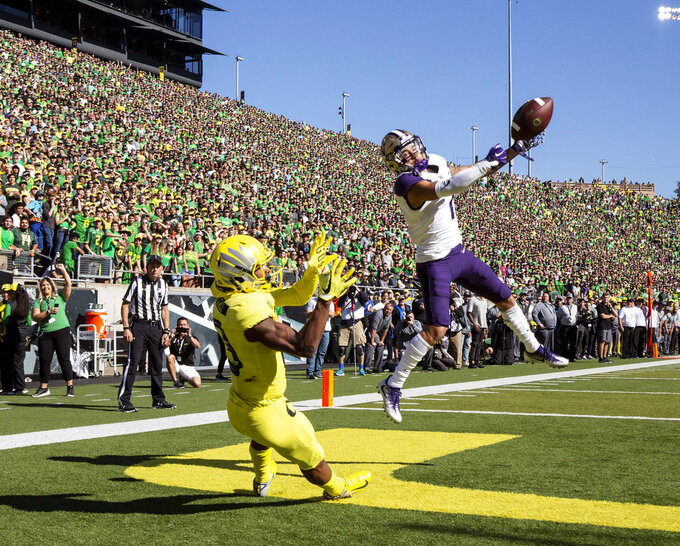 Washington defensive back Byron Murphy (1), breaks up a pass intended for Oregon wide receiver Dillon Mitchell (13), in the second quarter during an NCAA college football game in Eugene, Ore., Saturday, Oct. 13, 2018. (AP Photo/Thomas Boyd)
