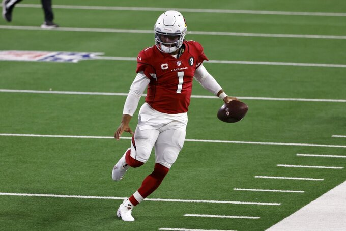 Arizona Cardinals quarterback Kyler Murray (1) heads to the sideline after gaining yardage carrying the ball against the Dallas Cowboys in the first half of an NFL football game in Arlington, Texas, Monday, Oct. 19, 2020. (AP Photo/Ron Jenkins)