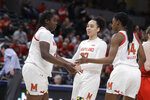 Maryland's Ashley Owusu (15) reacts to Blair Watson (22) and Diamond Miller (14) after Owusu hit a shot and was fouled during the first half of an NCAA college basketball championship game against Ohio State at the Big Ten Conference tournament, Sunday, March 8, 2020, in Indianapolis. (AP Photo/Darron Cummings)